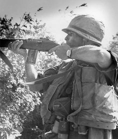 """""""Operation Utah—Marine from F Company, 2nd Battalion, 7th Marines, gets into a firing position and engages in a fire fight with the Viet Cong, just after being lifted to the position by helicopter."""" (4 Mar 1966) ~ Vietnam War"""