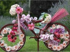 Beautiful Floral Bike ~ A lovely childhood memory ~ this reminds me of when we used to decorate our bikes for parades.