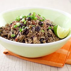 Cuban-Style Black Beans and Rice (Moros y Cristianos) :: America's Test Kitchen : Beans and rice is a familiar combination the world over, but Cuban black beans and rice is unique in that the rice is cooked in the inky concentrated liquid left over from cooking the beans, which renders the grains just as flavorful.
