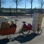 Ridiculously lot of boxes on a cargobike + trailer.