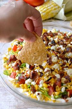 Cobb Dip is a delicious light dip made with creamy ranch, lettuce, tomatoes, grilled corn, shredded cheese, bacon, and blue cheese crumbles. The perfect party dip recipe! Jorden and I had quite the day yesterday. The kind of day where every step of the way feels like a feat. The kind of day where everyone around you seems 100 times more annoying than usual. The kind of day where all you can do is hold your breath and wait for it to be over. What happened, you ask? Absolutely nothing - just…