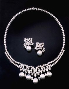 The Swan Lake Suite belonging to Lady Diana, Princess of Wales. The Princess wore this necklace to the royal gala performance of the ballet Swan Lake at the Royal Albert Hall in London in June Royal Jewelry, Pearl Jewelry, Jewelery, Vintage Jewelry, Fine Jewelry, Pearl Necklaces, Diamond Necklaces, Diamond Earrings, Lady Diana