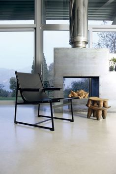 Choose a double-sided fireplace. Install your fireplace in front of floor-to-ceiling windows and you'll be able to catch a view of the outside as though you're having a bonfire in your living room.by usona Metal Fireplace, Contemporary Fireplace, Fireplace Design, Modern Living Room, Floor To Ceiling Windows, Outdoor Living Rooms, Modern Fireplace, Indoor Outdoor Fireplaces, Living Room Designs