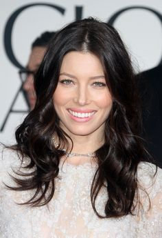 Former cover girl Jessica Biel's  almost-black waves make her fair skin and sweet, pink lips the center of attention.