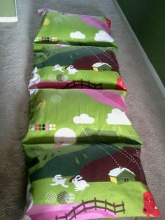 2 yards of ikea fabric, 4 ikea pillows, 30 minutes, and viola a pillow mattress for my kiddos!
