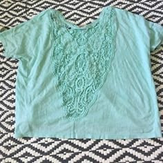 Lace back Tee Love this Flowy top. The first pic is the back of the shirt Tops
