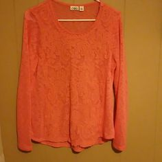 Cute sweater!! Really nice light weight sweater. Peach like in color. Has a cute lace like detail on the front. Only worn once! Cato Sweaters