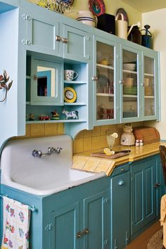 DIY:: Cottage kitchen with cabinets painted in teal and sky blue. So pretty !