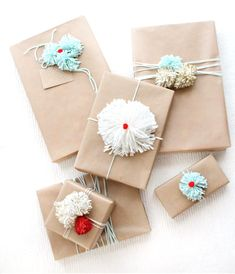 #DIY Pom Pom Gift Wrap Ideas fun to make with #kids  Before you start threatening pom pom rehab on me, let me say that in my defense, pom poms are light, fluffy, and pretty much perfect for holiday gift wrapping. They're just so cute! Add a little glitter and they're about as awesome confetti and cupcakes