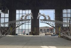 """This Robot Can 3-D Print A Steel Bridge In Mid-Air AUTODESK AND MX3D HAVE TEAMED UP ON A ROBOT THAT CAN ACTUALLY """"DRAW"""" CITY INFRASTRUCTURE, ON LOCATION AND WITHOUT HUMAN INTERVENTION; DETAILS."""