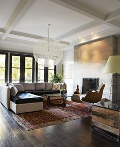 Oriental rug with rustic contemporary furnishings
