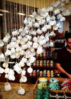 In-store coffee cup waterfall. with hooks near the coffee bar. just a hanging storage decor