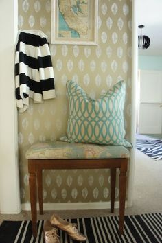 This stenciled wall (and tan/turquoise color combo) could be very cute in our hallway.