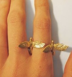 Double birds ring. This is beautiful, but I feel like it would get annoying...