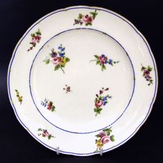 An 18th Century Sevres Porcelain Plate Decorated with Scattered Flowers. The Base with Royal French Monogram, Interlaced LLs (Used by Sevres from 1750 to 1793). Dated by Year Letter 'MM' to 1790. Painters Mark, Probably that of Jean-Jacques Pierre, known as Pierre jeaune, a Flower Painter Who Worked at Sevres From 1763 to 1800.