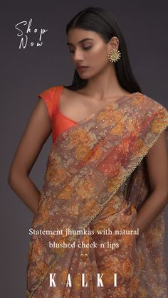 Peanut brown saree in organza with orange printed floral jaal pattern all over. Enhanced with foil printed dots all over and cut dana trim on the border. Teamed with a orange unstitched blouse in raw silk. Floral Print Sarees, Printed Sarees, Trendy Sarees, Stylish Sarees, Indian Wedding Outfits, Indian Outfits, Bollywood Outfits, Sari Dress, Organza Saree