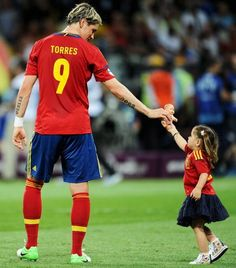 Fernando Torres with his daughter after winning Euro 2012