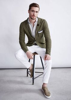 Rock an olive green wool sportcoat with white trousers to look classy but not particularly formal. Rock a pair of brown low top sneakers for a more relaxed aesthetic. Shop this look on Lookastic: https://lookastic.com/men/looks/blazer-long-sleeve-shirt-chinos/18720 — Grey Long Sleeve Shirt — Grey Pocket Square — Olive Wool Blazer — White Chinos — Brown Low Top Sneakers — Dark Brown Leather Belt