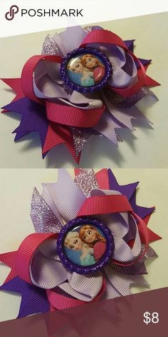 Anna & Elsa Frozen Hairbow Brand new. 4.5 inches.  Purple and pink glitter hairbow comes on an alligator clip.   Bundle and save!  Spend  $50 before shipping and get a FREE gift! Accessories Hair Accessories