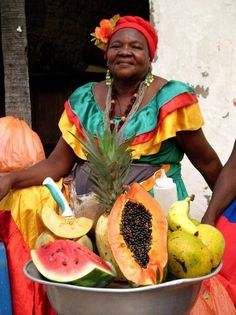 Palenquera Colombia--- bet the fruit tastes amazing --- not like the bland crap we get in the grocery stores.