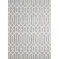Anchor your living room seating group or define space in the den with this artfully crafted wool rug, showcasing an intricate trellis motif for eye-catching ...