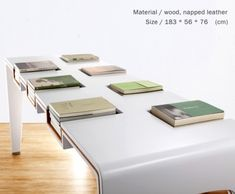 Table for books! really great coffee table idea, this way the books are interchangeable but also a piece of furniture. I would like this in a more traditional wood though. maybe different sized holes too.