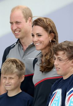 Kate Middleton Photos - The Duke and Duchess of Cambridge pose with members of the 1851 Trust charity as they visit the Land Rover BAR at the America's Cup World Series on July 24, 2016 in Portsmouth, England. - Duke And Duchess Of Cambridge At America's Cup World Series
