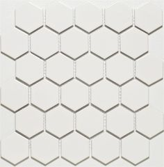 Glazed Porcelain 2 Hexagon Mosaics- White. This is a classic white hexagon pattern. Renovators and modernists alike can appreciate this adaptable geometric tile. The semi matte finish offers a crisp bright appearance that is easy to clean. Can be used alone as a field tile or as an accent to other tiles. The mesh backed tile sheets can be cut into different shapes to create custom accents.$4.59