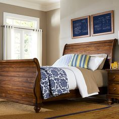 Brimming with rustic charm, this planked wood sleigh bed offers stylish appeal for your master suite or guest room.   Product: ...