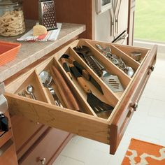 Cabinet and Drawer Organizers - this is good for those really long items that never quite fit in a normal size drawer