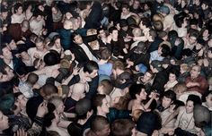 This is not a photo of a mosh pit, but a painting. Amazing! By Dan Witz
