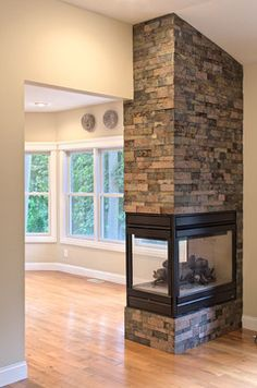 Custom Homes- InteriorS See-through stone fireplace