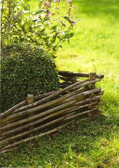 A simple, rustic garden fence, a great example of recycling