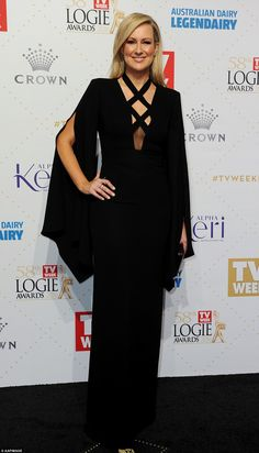 Black Beauty: Melissa Doyle stunned in a modern black Carla Zampatti gown with a stunning ...