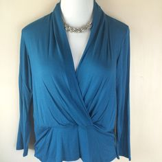 Teal Plus Size Top - Only 1 avail. Teal long sleeve plus top with surplice front and wide waistband. 97% polyester / 3% spandex. Only one available in each size: 1XL, 2XL, & 3XL. Not interested in trades. Toffs + Tufts Tops