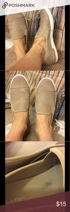 Calvin Klein tan colored snakeskin design loafer Very gently used Calvin Klein snakeskin design loafer Tan color One small discolored spot inside Does show some foot impressions inside shoe Bottoms show very little wear Does show some dirton rubber edging Size 8 1/2 Length from heel to toe is 10 1/2 inches Width is 3 1/2 inches Calvin Klein Shoes Flats & Loafers