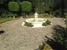 Circular concentric pattern, using sandstone Mosaic, Los Gatos, CA