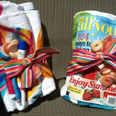 Teacher's gifts- end of year Beach towel, magazine, sunscreen, life rafts(candy), all tied in a cute ribbon.