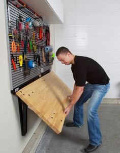 space saving garage organisation. The folding bench idea could be used in a laundry, a workroom... Garage diy tools organisation tips folding bench