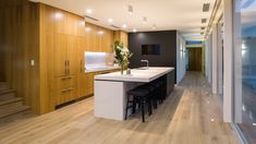Caesarstone® Calacatta Nuvo™. Miller Kitchens create a beautiful kitchen with Calacatta Nuvo™ and timber cabinetry which opens directly onto the pool area.   Builder: Stotty's Building​ Architecture: Damien McQuillan​ Photography: Robert Lang Photography​ Benchtop: Caesarstone® Calacatta Nuvo™​  #caesarstoneaustralia #caesarstoneau #Caesarstone #kitchendesign #kitchenideas #interiordesign #designinspiration #designideas #interiors #quartz #engineeredstone #homeideas #timber​ Calacatta Marble, Engineered Stone, Building Architecture, Beautiful Kitchens, Kitchen Design, Quartz, Design Inspiration, Interiors, Interior Design