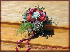 Natural organic bouquet with succulents, cymbidiums, proteas and carnations. It is also decorated with eucalyptus and a long burgundy ribbon. Wedding Flower Arrangements, Wedding Bouquets, Wedding Flowers, Succulent Bouquet, Marsala, Carnations, Succulents, Floral Wreath, Burgundy