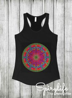 Designed by our own team to make you look awesome! This mandala is designed to offer a visual balance of elements that symbolize harmony and unity. When used in a spiritual practice, the mandala is said to help absorb the mind in meditation. This versatile racerback was designed to stay put—and out of your way—when you're on the move. Get it before it's gone! #yoga #racerback #mandala #tank_top #tanktop #woman #boho #bohemian #yoga_fashion #fashion #yoga_clothing #gypsy #hippie