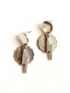 The Burma Bolt Baubler Earrings are created with vintage Burma coins from India and a faceted gemstone lightning bolt. These earrings are lightweight, nickel-free and hypoallergenic. Lightning Bolt, Design Show, Silver Coins, Statement Jewelry, Studs, Brass, Stud Earrings, Gemstones, Personalized Items