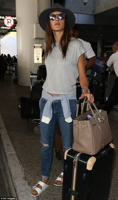 Effortless: Rounding-off her laid-back look, the mother-of-two wore a pair of white Birken...