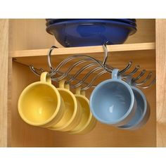 Hanging your cups will free up the space of your shelves! #organizing