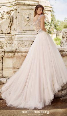 Courtesy of Martin Thornburg Collection of Mon Cheri Wedding Dresses