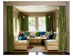 It's no boring conversation nook—in this Atlanta home designed by Wendy Blount, the alcove off the living room becomes one of the most desirable spaces for kicking back. She installed green silk drapery in the four corners, and aqua pillows on the sectional sofa to make the cozy space the center of attention.