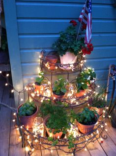 deck lighting using mason jars filled with lights between potted plants! deck lighting using Christmas Lights Inside, White Christmas, Christmas Decor, Vintage Outdoor Decor, Potted Plants Patio, Mason Jars, Garden Bed Layout, Deck Decorating, Deck Lighting