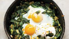 Skillet-Baked Eggs with Spinach, Yogurt, and Chili Oil Recipe