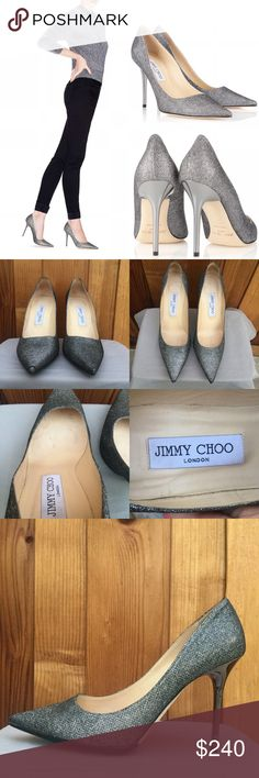 "Jimmy Choo Abel Anthracite Glitter Pointy Toe Pump 100% authentic Jimmy Choo Abel pumps, size 38.5.  The color is ""Anthracite"" (dark gray metallic glitter).  There is wear to the insoles, back linings, and front tips of the shoes.  Also, the bottoms show minor wear, but Vibram soles were added.  The heels, heel tips, and exterior look excellent; No missing glitter.  No box/dust bag.  * Pointed toe * 4"" shiny, reflective heel * Padded leather insole * Leather lining and outsole * Made in…"